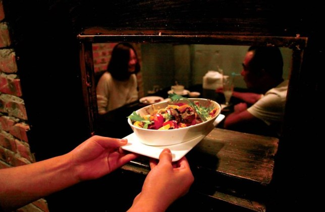 """Mandatory Credit: Photo by Imaginechina/REX (4101921c)  Customers dine at a prison-themed restaurant  Prison-themed restaurant opens in Tianjin, China - 06 Sep 2014  A special restaurant modeled on prison cells opened recently in Tianjin city, China. According to the owner he wants diners to 'cherish their freedom and stay away from crimes'. Each private dining room takes the form of a separate """"cell"""" made from iron caging."""