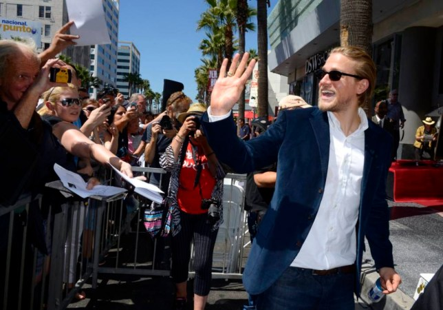 epa04393209 English actor Charlie Hunnam waves to fans following US actress Katey Sagal's star ceremony on the Hollywood Walk of Fame in Hollywood, California, USA 09 September 2014. Sagal was awarded the 2,529th star on the Hollywood Walk of Fame in the category of Television.  EPA/PAUL BUCK