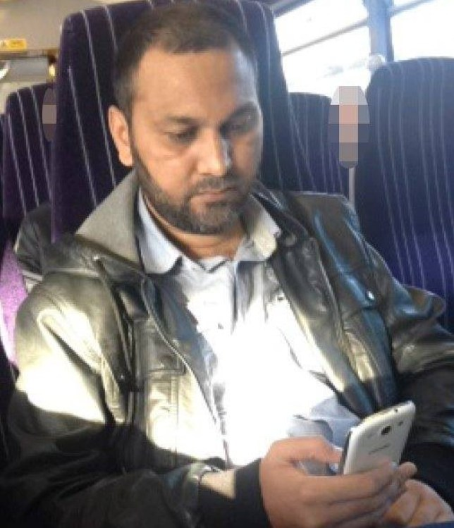 Raja Hussain, pictured opposite the victim on the train, had allegedly looked at naked pictures of women on his phone before the attack (Picture: Ross Parry)