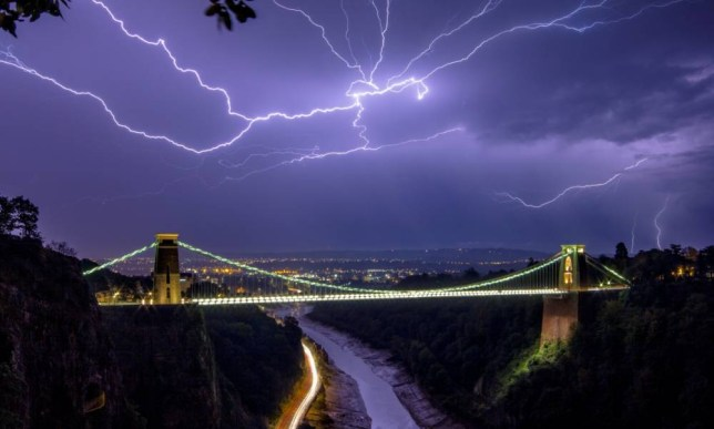 Lightning forks over the Clifton Suspension bridge, Bristol in the early hours of September 19 2014. The UK was hit by violent thunder storms last night with flash flooding reported in areas.