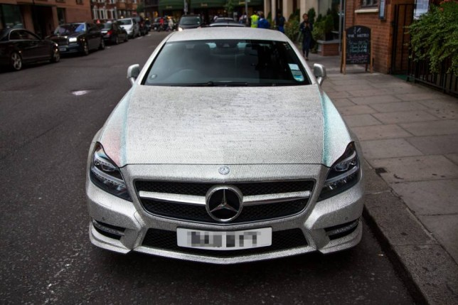 This unique Mercedes was stopping traffic yesterday (Mon) after its owner had the covered in DIAMONDS. See SWNS story SWDIAMOND; The diesel Mercedes CLS is thought to be owned by a Russian woman who lives in London. And she has managed to outdo the Arab playboys who drive around the capital by having her car covered in thousands of Swarovski diamonds. The Mercedes caused a stir yesterday (Mon) when it was parked outside a restaurant on Basil Street, near Harrods in Knightsbridge.