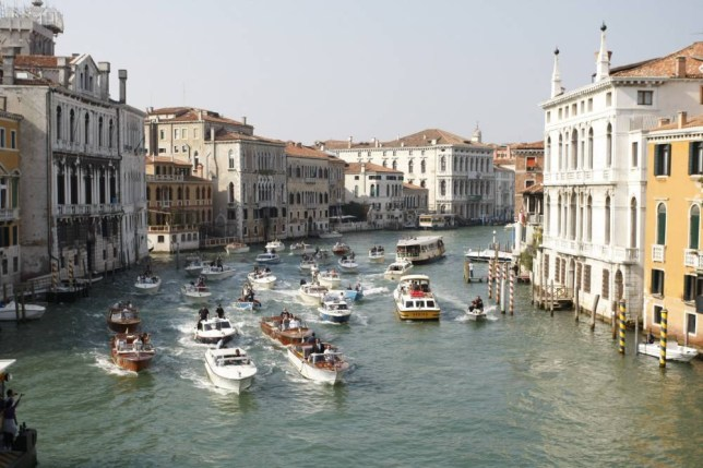 "A general view shows boats surrounding the taxi boat of US actor George Clooney and his wife Amal Alamuddin on September 28, 2014 on the Grand Canal in Venice. Hollywood heartthrob George Clooney and Lebanese-British lawyer Amal Alamuddin married in Venice on Saturday September 27, 2014 before partying the night away with their A-list friends in one of the most high-profile celebrity weddings in years. ""George Clooney and Amal Alamuddin were married today (September 27) in a private ceremony in Venice, Italy,"" Clooney spokesman Stan Rosenfield said. The announcement came as a surprise as the pair were not expected to officially tie the knot until Monday, though they are still tipped for a civil ceremony at the town hall to officialise the marriage under Italian law.  AFP PHOTO / PIERRE TEYSSOTPIERRE TEYSSOT/AFP/Getty Images"