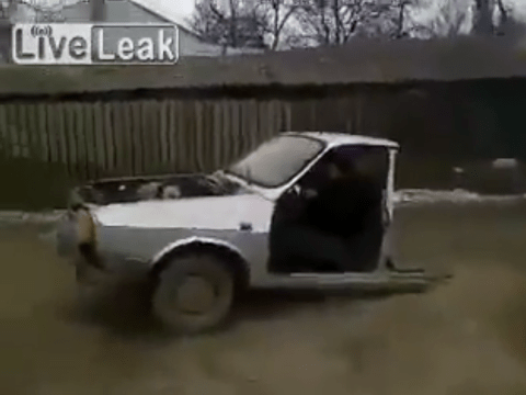We're not sure what's funnier – the half car or the guy's laugh
