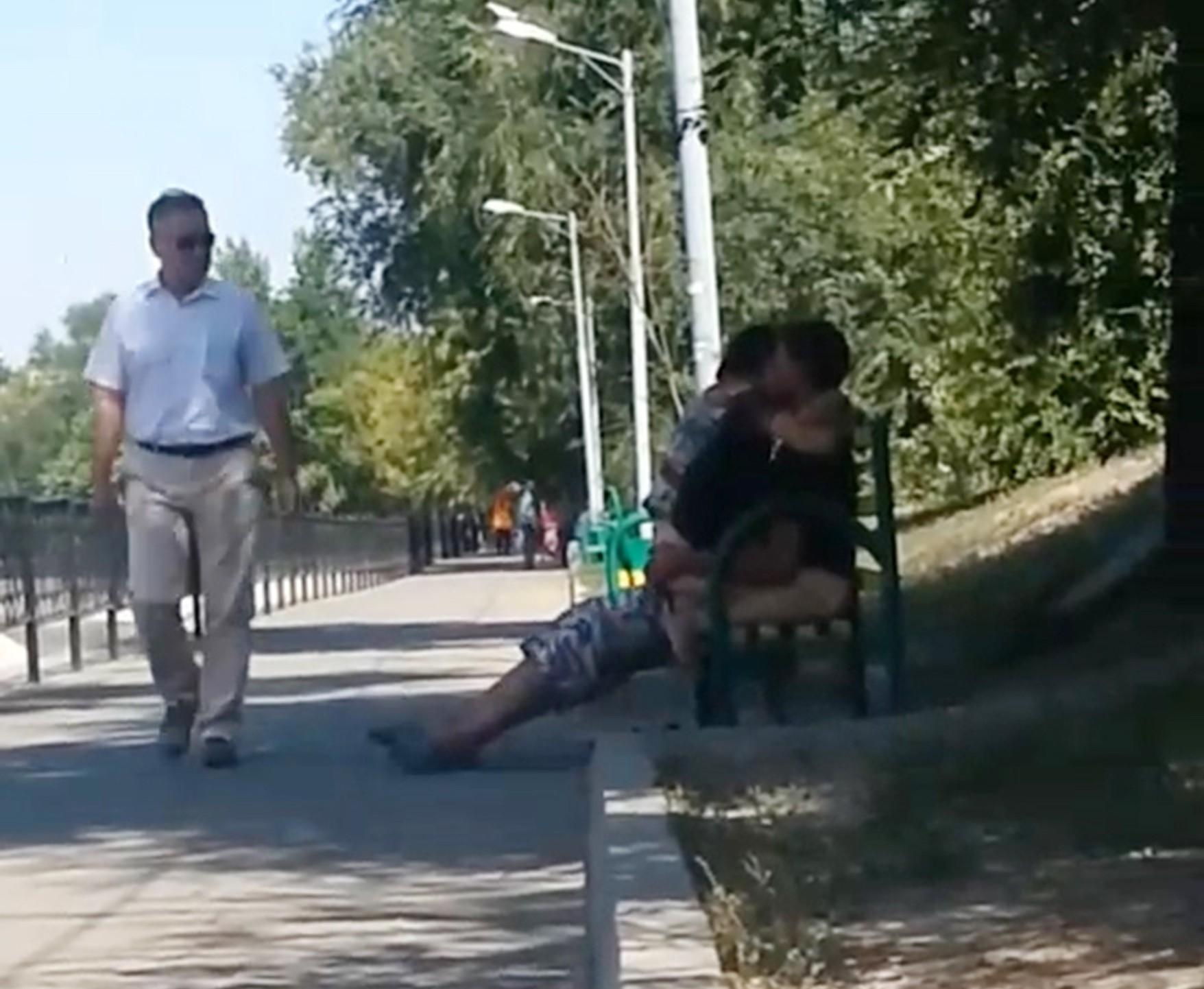 Couple caught on park bench having sex