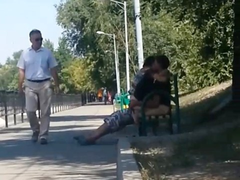 Couple caught on park bench having sex