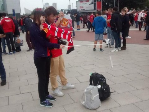 'Selfie-stick' spotted at Manchester United as worrying craze spreads across the country