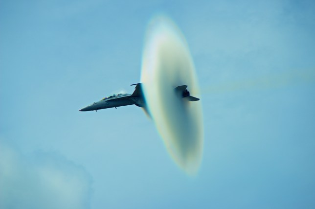An F-18 Super Hornet creates an astonishing 'shock egg' as it nears the speed of sound (Picture: Joseph Broyles/Caters)