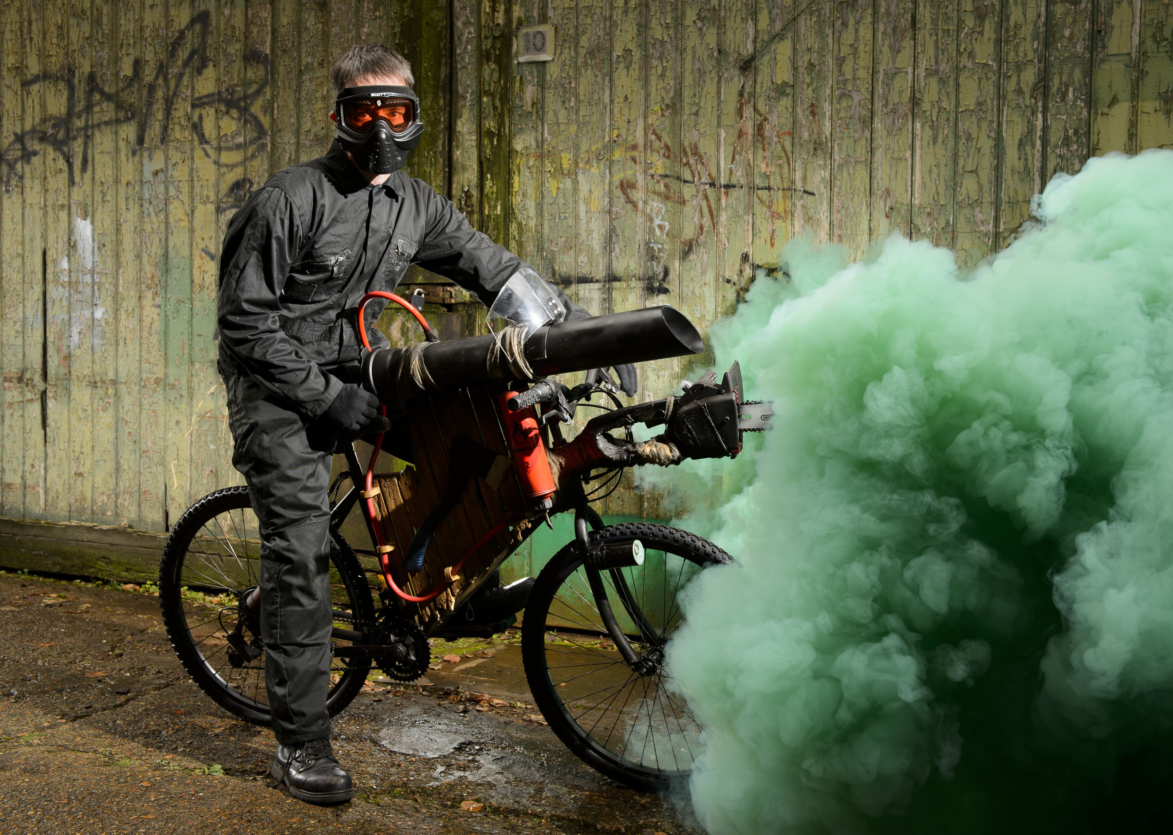 The bike comes with flamethrowers, a chainsaw and a splatter shield. (Picture: REX)