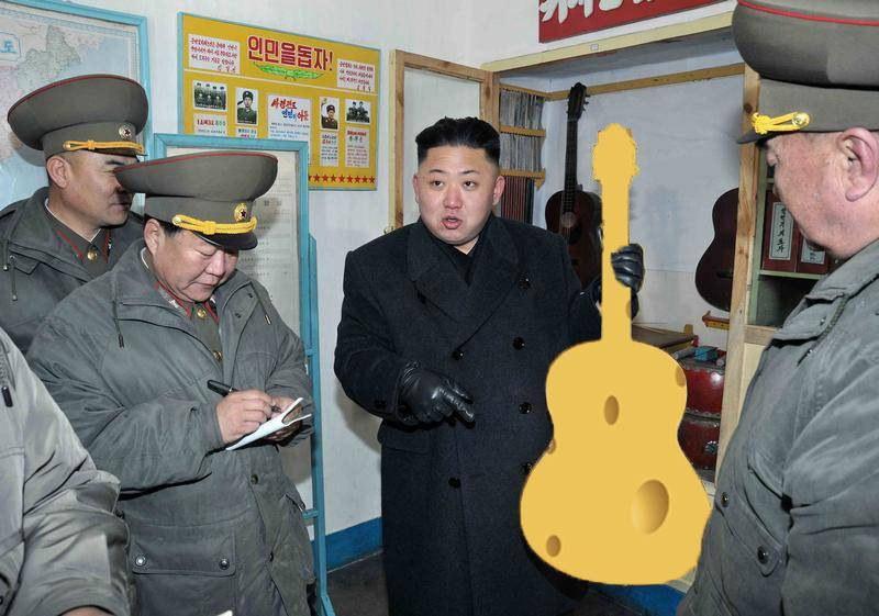 North Korean leader Kim Jong-Un (C) holds a guitar during his visit to a military unit on the Wolnae Islet Defence Detachment in the western sector of the front line, which is near Baengnyeong Island of South Korea March 11, 2013 in this picture released by the North's official KCNA news agency in Pyongyang March 12, 2013. South Korea and U.S. forces are conducting large-scale military drills, while the North is also gearing up for a massive military exercise. North Korea has accused the U.S. of using the military drills in the South as a launch pad for a nuclear war and has said to scrap the armistice with the U.S. that ended the 1950-53 Korean War.  REUTERS/KCNA (NORTH KOREA - Tags: POLITICS MILITARY CIVIL UNREST) ATTENTION EDITORS - THIS PICTURE WAS PROVIDED BY A THIRD PARTY. REUTERS IS UNABLE TO INDEPENDENTLY VERIFY THE AUTHENTICITY, CONTENT, LOCATION OR DATE OF THIS IMAGE. THIS PICTURE IS DISTRIBUTED EXACTLY AS RECEIVED BY REUTERS, AS A SERVICE TO CLIENTS. QUALITY FROM SOURCE. NO THIRD PARTY SALES. NOT FOR USE BY REUTERS THIRD PARTY DISTRIBUTORS - RTR3EVHY
