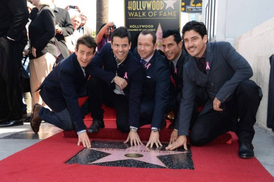 New Kids on The Block members (L-R) Joey McIntyre, Jordan Knight, Donnie Wahlberg, Danny Wood and Jonathan Knight pose as they are honored with a star on the Hollywood Walk of Fame on October 9, 2014 in Hollywood, California. The multi-platinum selling, award-winning musicial group received the 2,530th star in the category of Recording.  AFP PHOTO / Robyn BeckROBYN BECK/AFP/Getty Images