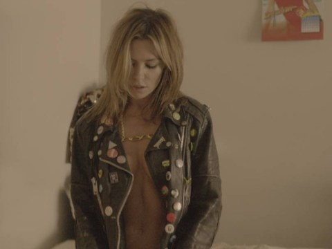 Abbey Clancy straddles a guitar while semi-naked in seriously sexy Vauxhall Adam Rocks Air cars advert