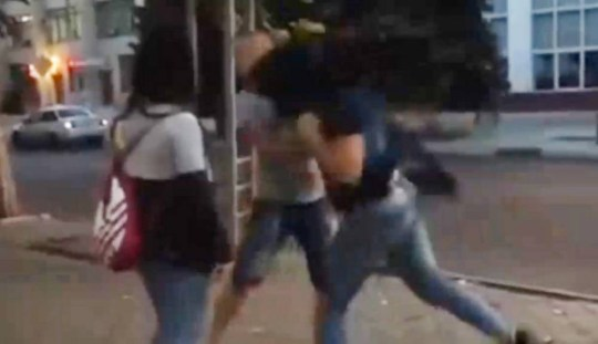 """Pic shows: Two women punch Kondrat Golubev after he asked them how much it would cost for sex. Cops are hunting two women who laid a man out flat with one punch after he asked them how much it would cost for sex, and then kicked him in the private parts for good measure. Kondrat Golubev, 32, had been clubbing with mates in Borat land in the city of Atyrau in Eastern Kazakhstan, when he went outside for a cigarette and spotted the two girls. Feeling frisky he approached them and asked them how much they charged. Club-goer Anatoli Pokrovski, 36, who shot the video of the argument said: """"I was outside waiting for my girlfriend who was getting her coat when I saw an argument break out between the man and two women. """"He obviously thought that he was in with a chance, as he tried to ask them for a drink, and when they told him to get lost, he decided to insult them by asking of they were prostitutes and how much it would cost. """"The women were clearly offended and he never expected what happened next, even though the woman really telegraphed the punch. She hit him so hard he fell flat on the pavement. """"Her friend then kicked him before the other one told her to leave him, saying heíd had enough. """"They then walked off as if nothing had happened."""" """"It was pretty shocking really, but what a punch."""" Police say they are now hunting the two women. A spokesman said: """"We have seen the video and believe the woman who threw the punch is trained in some form of martial arts. """"We donít think she is a boxer because of the way her thumb extends over the top of her index finger. """"But the force behind that punch was so great we suspect this is not the first time she has hit something hard."""" The man was taken to hospital where doctors said he was suffering from concussion. (ends)¿¿"""
