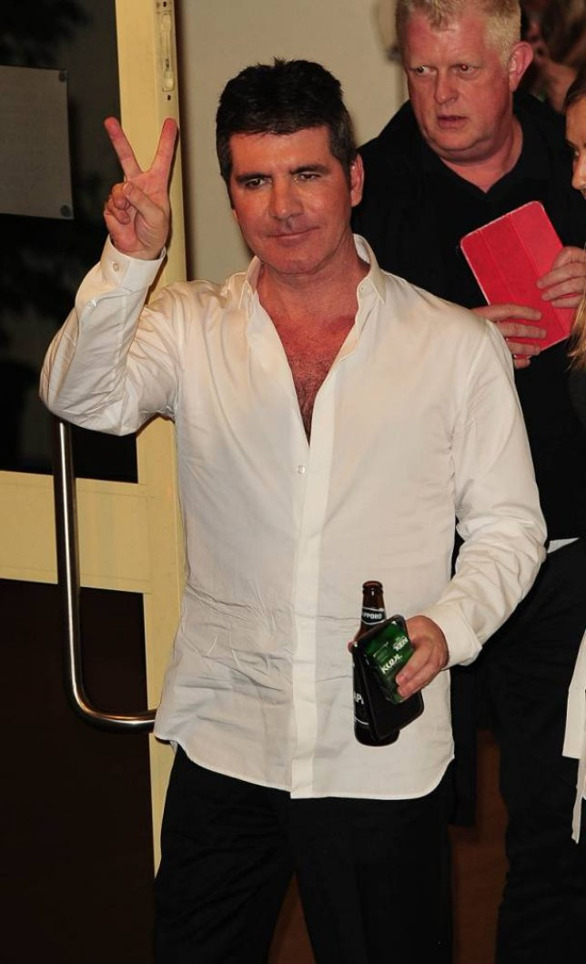 19 Oct 2014 - LONDON  - UK  SIMON COWELL PICTURED LEAVING THE X FACTOR STUDIOS HOLDING HIS BOTTLE OF BEER   BYLINE MUST READ : XPOSUREPHOTOS.COM  ***UK CLIENTS - PICTURES CONTAINING CHILDREN PLEASE PIXELATE FACE PRIOR TO PUBLICATION ***  **UK CLIENTS MUST CALL PRIOR TO TV OR ONLINE USAGE PLEASE TELEPHONE   44 208 344 2007 **