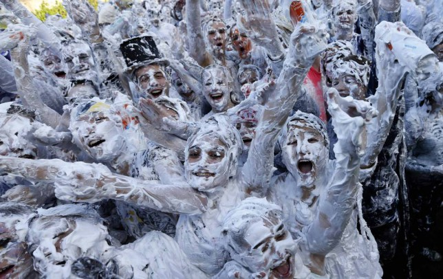 Students show Ibiza revelers how a foam party is done at the Raisin Monday at St Andrews University
