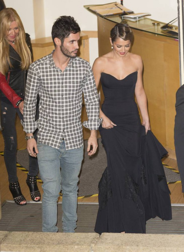26 Oct 2014 - LONDON   - UK   X FACTOR JUDGES LEAVE THE LONDON STUDIOS - CHERYL LEAVES WITH HUSBAND IN BLACK DRESS    PLEASE CREDIT : PETTS-MOORE / XPOSUREPHOTOS.COM  ***UK CLIENTS - PICTURES CONTAINING CHILDREN PLEASE PIXELATE FACE PRIOR TO PUBLICATION ***  **UK CLIENTS MUST CALL PRIOR TO TV OR ONLINE USAGE PLEASE TELEPHONE   44 208 344 2007 **