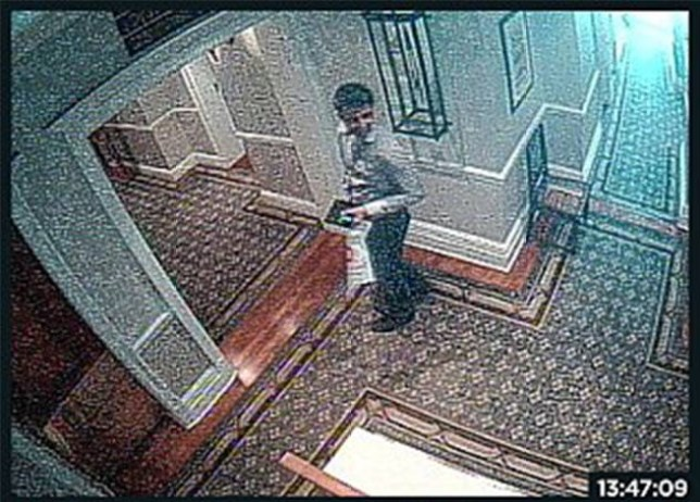 Grab from CCTV showing the moment Shrien Dewani hands over a bag of money to taxi driver Zola Tonga for arranging the murder of his bride Anni Dewani in South Africa.