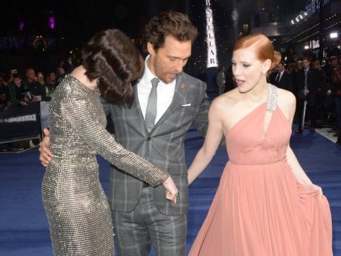 Matthew McConaughey and his clumsy feet stomp all over Jessica Chastain's dress at Interstellar London premiere