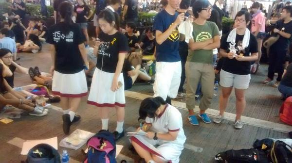 No protest for democracy is going to stop these students from finishing their homework