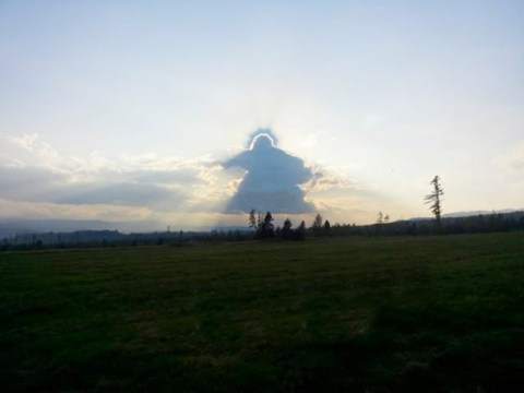 Clouds form a perfect angel in the sky – complete with halo