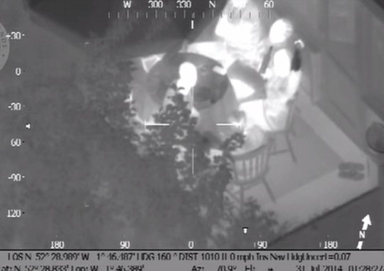 What appears to be a woman offers bottles to the helicopter crew (Picture: West Midlands Police)