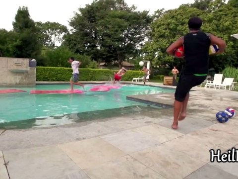 Ronaldinho pelts balls at people running across his swimming pool