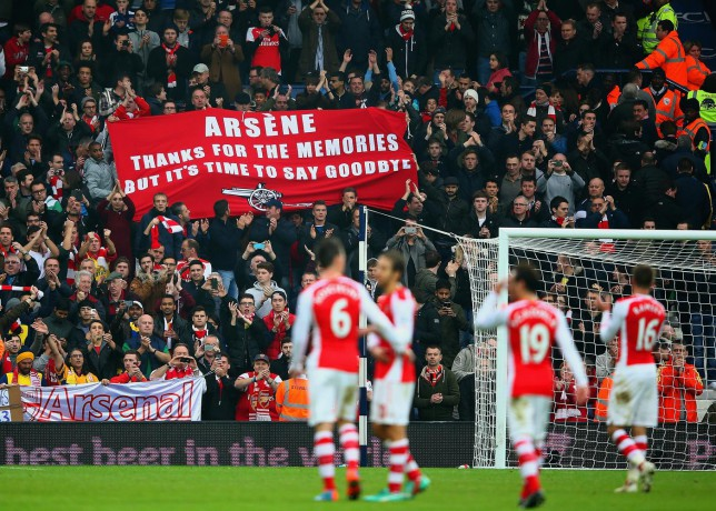 WEST BROMWICH, ENGLAND - NOVEMBER 29: Arsenal fans hold up a banner for Arsene Wenger, manager of Arsenal during the Barclays Premier League match between West Bromwich Albion and Arsenal at The Hawthorns on November 29, 2014 in West Bromwich, England Mark Thompson/Getty Images