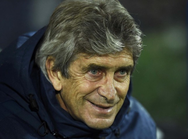 Manchester City manager Manuel Pellegrini smiles before the start of their English Premier League soccer match against Queens Park Rangers at Loftus Road in London November 8, 2014. REUTERS/Dylan Martinez (BRITAIN - Tags: SPORT SOCCER) FOR EDITORIAL USE ONLY. NOT FOR SALE FOR MARKETING OR ADVERTISING CAMPAIGNS. EDITORIAL USE ONLY. NO USE WITH UNAUTHORIZED AUDIO, VIDEO, DATA, FIXTURE LISTS, CLUB/LEAGUE LOGOS OR 'LIVE' SERVICES. ONLINE IN-MATCH USE LIMITED TO 45 IMAGES, NO VIDEO EMULATION. NO USE IN BETTING, GAMES OR SINGLE CLUB/LEAGUE/PLAYER PUBLICATIONS. Dylan Martinez/Reuters