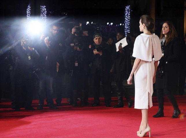 "Director Angelina Jolie poses for a photograph as she arrives for the UK premiere of ""Unbroken"" in central London (Picture: Paul Hackett/Reuters)"