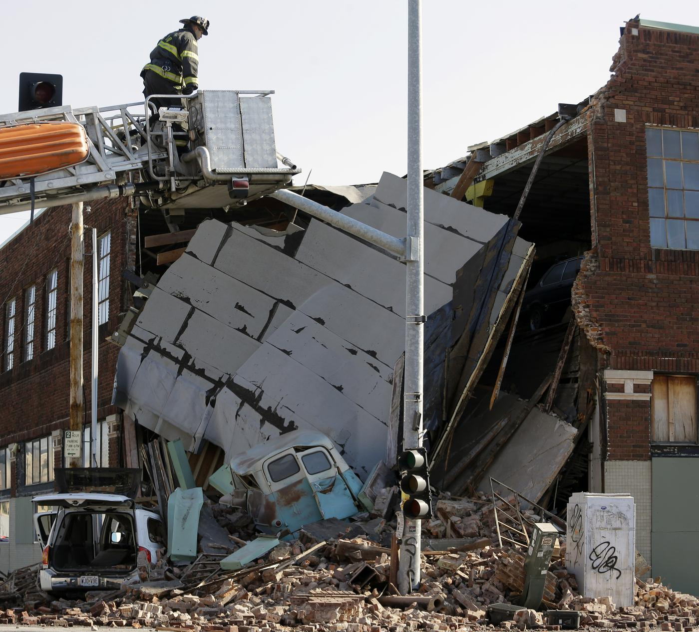 Woman flees the police, drives SUV into building, causing it to collapse