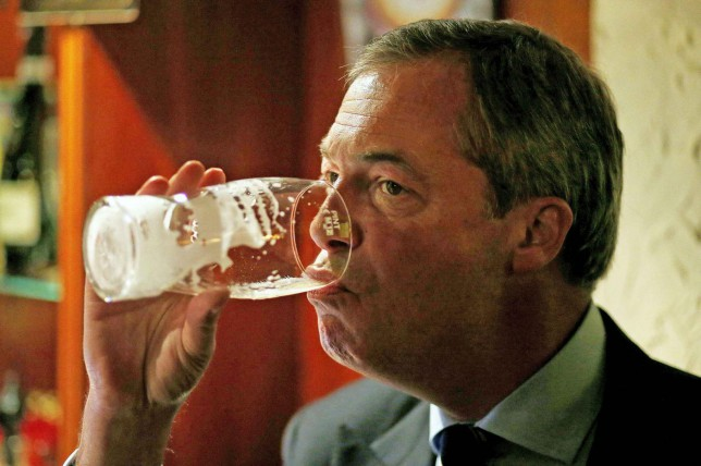 Nigel Farage, the leader of the United Kingdom Independence Party (UKIP) drinks a pint of beer in the Gardeners Arms pub in Heywood near Manchester, northern England October 7, 2014. Heywood will hold a by-election on October 9 following the death of Labour MP Jim Dobbin. REUTERS/Phil Noble (BRITAIN - Tags: POLITICS SOCIETY TPX IMAGES OF THE DAY) Phil Noble/Reuters