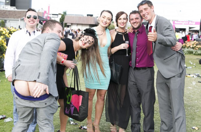 A group of racegoers pose for a photo as one member of the group pulls his pants down during the Emirates Melbourne Cup Day held at Flemington Racecourse in Melbourne Australia.