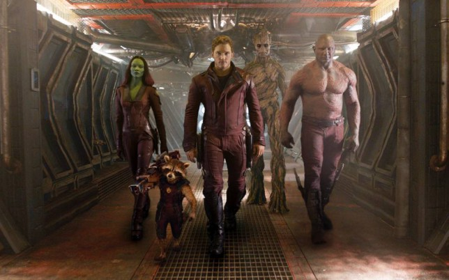 """Film: Guardians of the Galaxy (2014), starring Zoe Saldana as Gamora, Chris Pratt as Peter Quill and Dave Bautista as Drax.  This undated image released by Disney - Marvel shows, from left, Zoe Saldana, the character Rocket Racoon, voiced by Bradley Cooper, Chris Pratt, the character Groot, voiced by Vin Diesel and Dave Bautista in a scene from """"Guardians Of The Galaxy"""".  FILE. (AP Photo/Disney - Marvel, File)"""