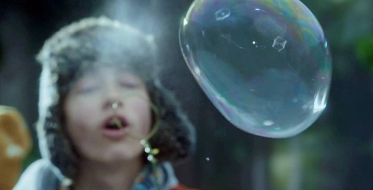 An incredible natural phenomenon has been captured on video for the first time ñ showing washing-up bubbles FREEZING in the air. See SWNS story SWICE; The remarkable footage, filmed on cameras four-times sharper than standard HD quality, shows a group of children blowing bubbles in a snowy forest. The film, shot in the freezing Canadian forests near Whistler, and records the unique process of bubbles crystallising and turning into hollow blocks of ice ñ without any computer-generated wizardry. Bubbles, blown in the time-honoured tradition of mixing washing-up liquid with water, rapidly freeze as soon as they hit the sub-zero air, before slowly floating to the ground. The icy bubbles are tough enough to be held in a hand, but when they pop, the ice shatters and flies out in all directions.