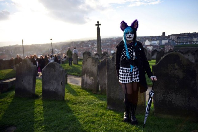 "TOPSHOTS A woman dressed in a costume is pictured during the biannual ""Whitby Goth Weekend"" (WGW) festival in Whitby, Northern England, on November 2, 2014. The WGW festival brings thousands of goths and alternative lifestyle fans from the UK and around the world over a weekend of music, dancing and shopping.  AFP PHOTO / OLI SCARFFOLI SCARFF/AFP/Getty Images"