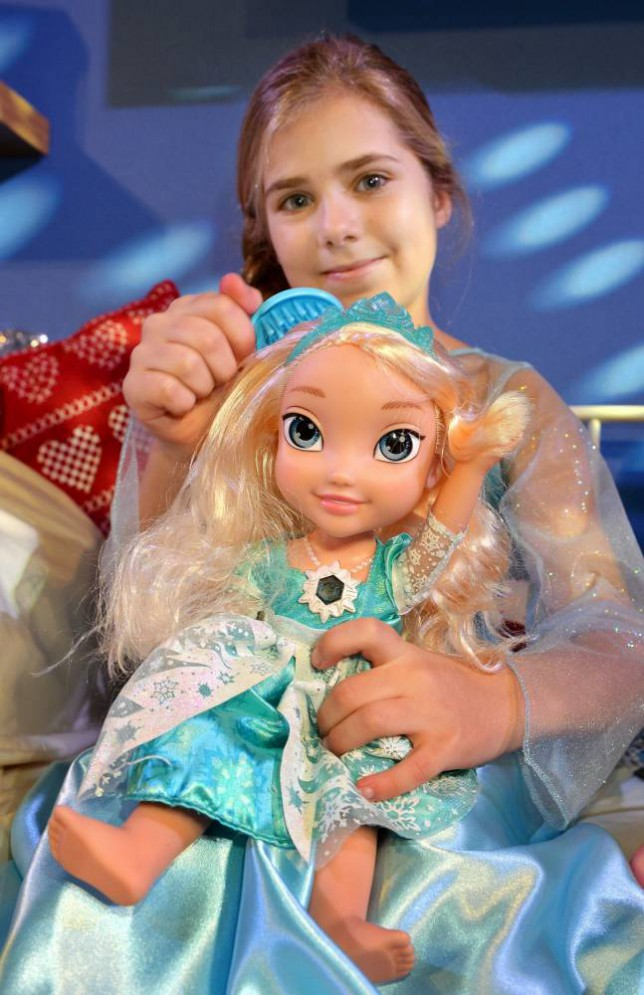 Gracie Tomlinson, ten, plays with a Frozen Snow Glow Elsa Doll, one of the top twelve toys that are expected to be among the best sellers for children this coming Christmas, on view at the DreamToys 2014 list announcement in central London. PRESS ASSOCIATION Photo. Picture date: Wednesday November 5, 2014. See PA story CONSUMER Toys. Photo credit should read: John Stillwell/PA Wire