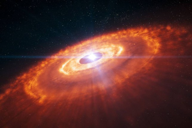 An artist's impression of a young star surrounded by a protoplanetary disc in which planets are forming is seen in this handout image provided by European Southern Observatory (ESO) on November 6, 2014. Concentric rings of gas, with gaps indicating planet formation, are visible in this artist's impression and were predicted by computer simulations. Some of the most detailed images ever taken of new planets being born around a star were published on Thursday, which astronomers said could transform theories about planet formation. REUTERS/ESO/Handout via Reuters (CHILE - Tags: SCIENCE TECHNOLOGY)   ATTENTION EDITORS - THIS PICTURE WAS PROVIDED BY A THIRD PARTY. REUTERS IS UNABLE TO INDEPENDENTLY VERIFY THE AUTHENTICITY, CONTENT, LOCATION OR DATE OF THIS IMAGE. FOR EDITORIAL USE ONLY. NOT FOR SALE FOR MARKETING OR ADVERTISING CAMPAIGNS. THIS PICTURE IS DISTRIBUTED EXACTLY AS RECEIVED BY REUTERS, AS A SERVICE TO CLIENTS. NO SALES. NO ARCHIVES