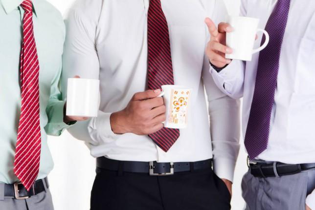 Men enjoying a cup of tea at work