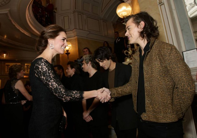 Britain's Catherine, Duchess of Cambridge (L) meets boy band, One Direction at the Royal Variety Performance at the London Palladium Theatre on November 13, 2014. The Royal Variety Performance takes place annually in aid of the Entertainment Artistes Benevolent Fund (EABF) which cares for hundreds of entertainers throughout the UK who need help and assistance as a result of old age, ill-health or hard times. AFP PHOTO / POOL / YUI MOKYUI MOK/AFP/Getty Images