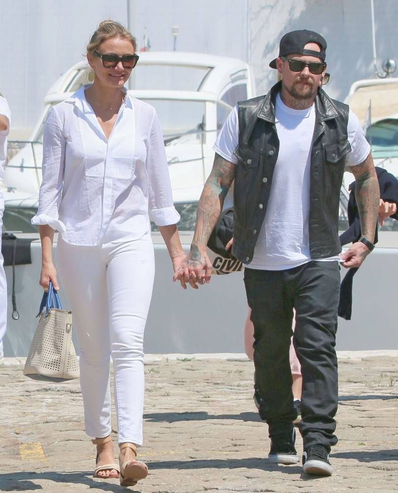 Actress Cameron Diaz and her guitarist boyfriend Benji Madden snapped while on vacation in Beaulieu, France on July 26, 2014.    Couple Cameron Diaz and her rocker boyfriend Benji Madden stepping off their yacht while on vacation in Beaulieu, France.    The happy couple were all smiles as they held hands nearly the entire time. Cameron also said goodbye the crew by giving them all hugs.     Non Exclusive  UK RIGHTS ONLY    Pictures by : FameFlynet UK   2014  Tel : +44 (0)20 3551 5049  Email : info@fameflynet.uk.com