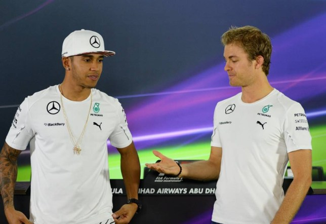 Mercedes-AMG's British driver Lewis Hamilton (L) and Mercedes-AMG's German driver Nico Rosberg pose before the press conference at the Yas Marina circuit in Abu Dhabi on November 20, 2014, ahead of the Abu Dhabi Formula One Grand Prix.  AFP PHOTO / TOM GANDOLFINITom Gandolfini/AFP/Getty Images