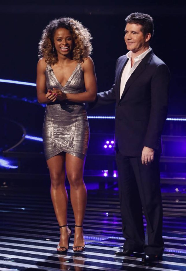 *** MANDATORY BYLINE TO READ: Syco / Thames / Corbis ***<BR /> X Factor judges, contestants and guests are seen performing on the X Factor live show in London. Credit: Dymond/Syco/Thames/Corbis <P> Pictured: Simon Cowell, Fleur East  <B>Ref: SPL896829  221114  </B><BR /> Picture by: Dymond / Syco / Thames / Corbis<BR /> </P>