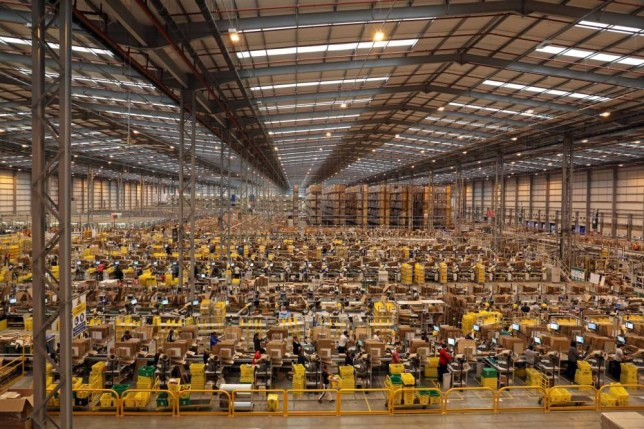 Workers pack orders on the warehouse floor at the Amazon UK Fulfilment Centre in Peterborough, Cambridgeshire. PRESS ASSOCIATION Photo. Picture date: Tuesday November 25, 2014. Photo credit should read: Chris Radburn/PA Wire