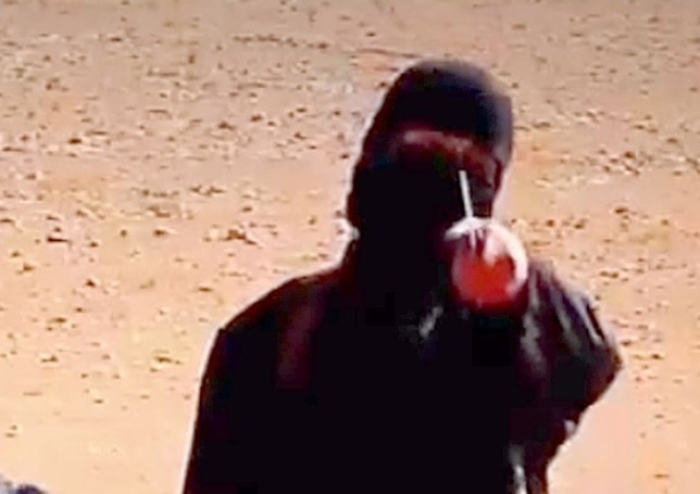 The masked executioner has become well-known due to his gruesome online videos where he kills hostages (Rex)