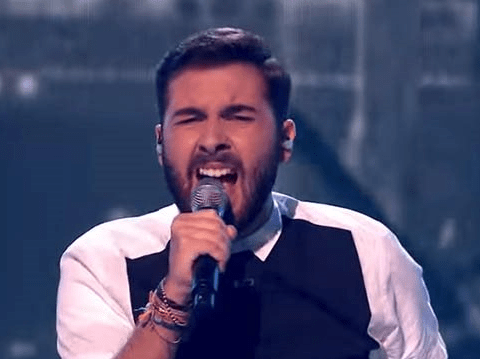 X Factor's Andrea Faustini is refusing to ditch the creepy faces for Simon Cowell