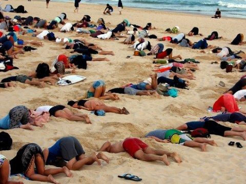 Why are these people burying their heads in the sand? (Literally)