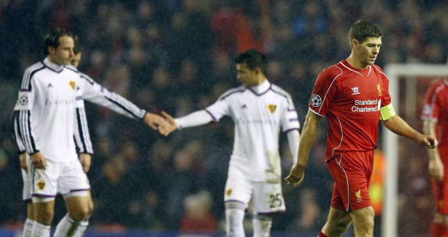 Liverpool's Steven Gerrard, right, leaves the field at half time during the Champions League Group B soccer match between Liverpool and FC Basel at Anfield Stadium in Liverpool, England, Tuesday, Dec. 9, 2014. (AP Photo/Jon Super) AP Photo/Jon Super