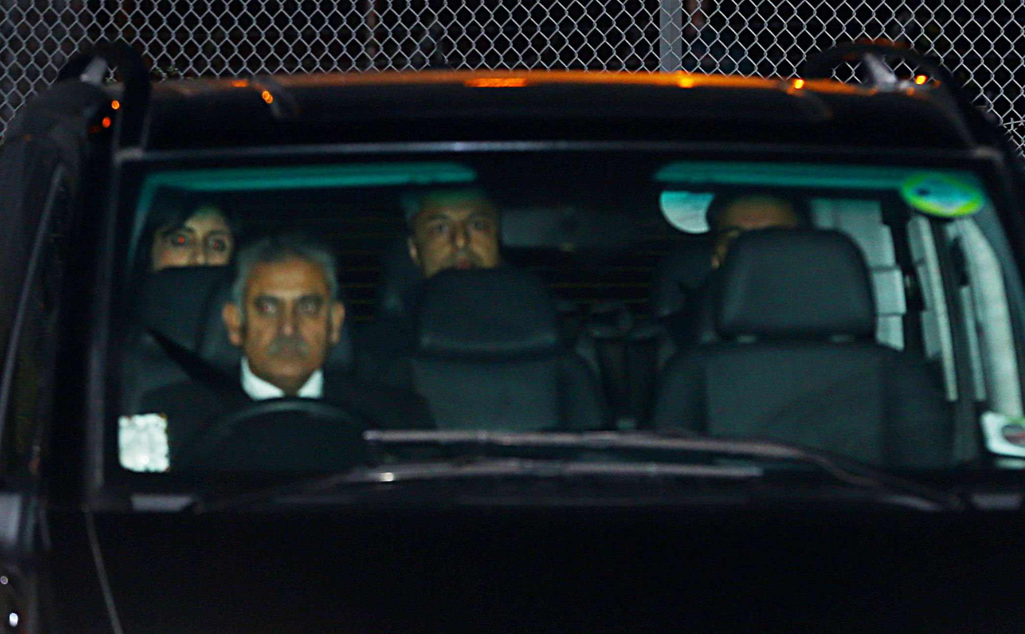 Dewani pictured on the back seat of a car as he is driven away from Gatwick Airport Picture: PA)