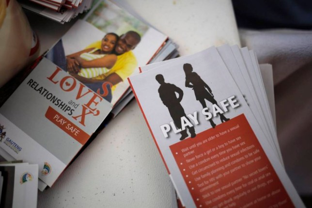 epa04510508 Public Aids education information is seen at a public Aids testing event during a World Aids Day in downtown Johannesburg, South Africa, 01 December 2014. The event hosted by local government offered public HIV Aids testing free of charge.  EPA/KIM LUDBROOK