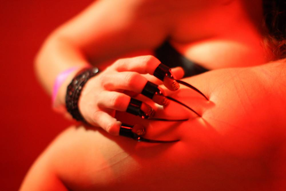 LOS ANGELES, CA - MAY19: Mistress Tetra drags metal claws over the skin of Katie who is a willing submissive at a dungeon party during the DomConLA convention in the early morning hours of May 19, 2012 in Los Angeles, California. DomCon brings together enthusiasts of BDSM (Bondage, Discipline, Submission and Dominance) and other sexual fetishes. The convention, started in 2003 by fetish professional, Mistress Cyan, is claimed to be the largest convention of its kind in the U.S. DomConLA will continue through May 20. (Photo by David McNew/Getty Images)