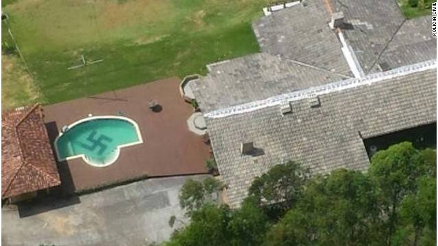 Police helicopter spots swastika in private garden swimming pool